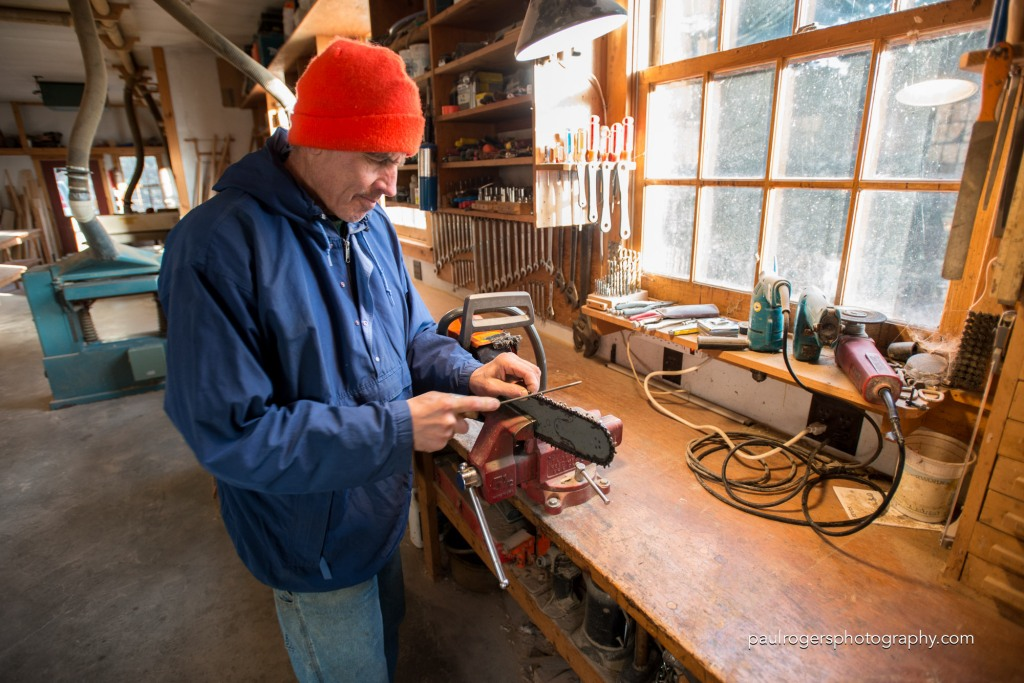 The day starts in the wood shop were Chief of Operations sharpens his chain saw.