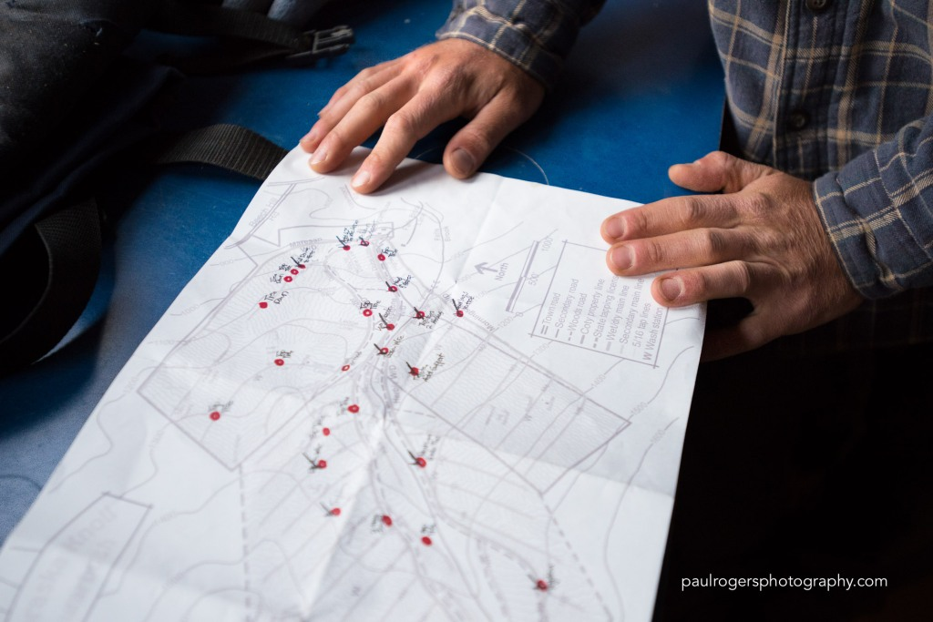 On this map of the sugarbush, the crew has marked in red the problem area they came upon while repairing tubing: Tree fell over line. Dead tree at top of main line needs to be topped. Hole in line. Microburst section, many dead trees along main line.